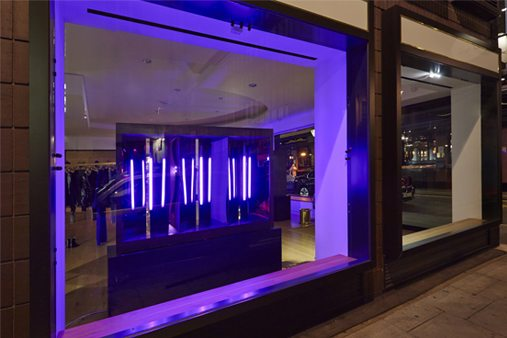 Exterior shot of the Paul Smith window, featuring a bespoke neon lighting display created by Prop Studios