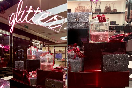 The large production run of pink, red and grey acrylic plinths displayed Anya Hindmarch's latest range of glitter accessories