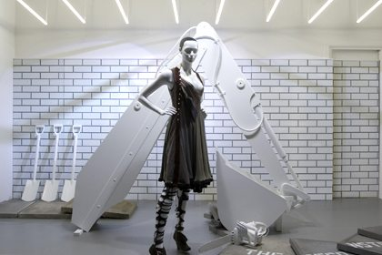 Mannequin in front of giant digger sculpture, created for Selfridges exclusively by Prop Studios