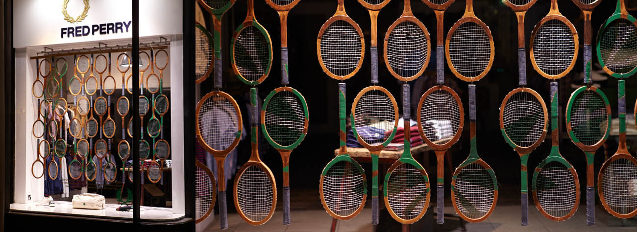 Close-up of the custom-designed tennis racquets, displayed within the window of Fred Perry
