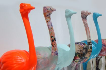 Line-up of six Prop Studios ostrich sculptures, waiting to be delivered to the Topshop store