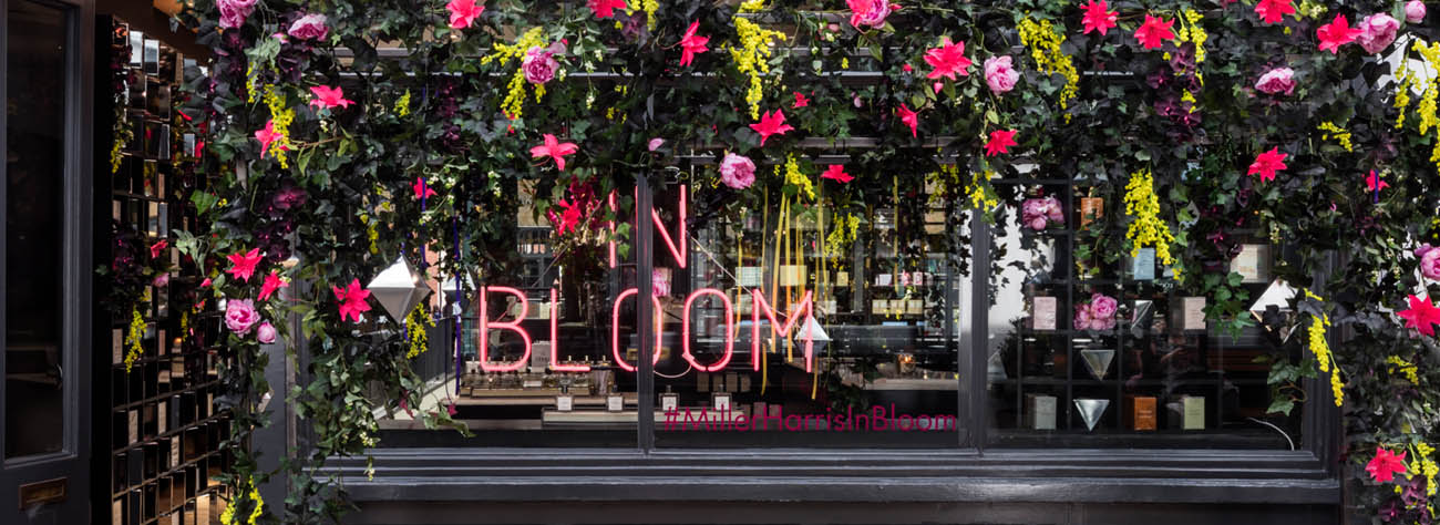 Landscape shot of Covent Garden In Bloom sign as part of Prop Studios' window design for Miller Harris