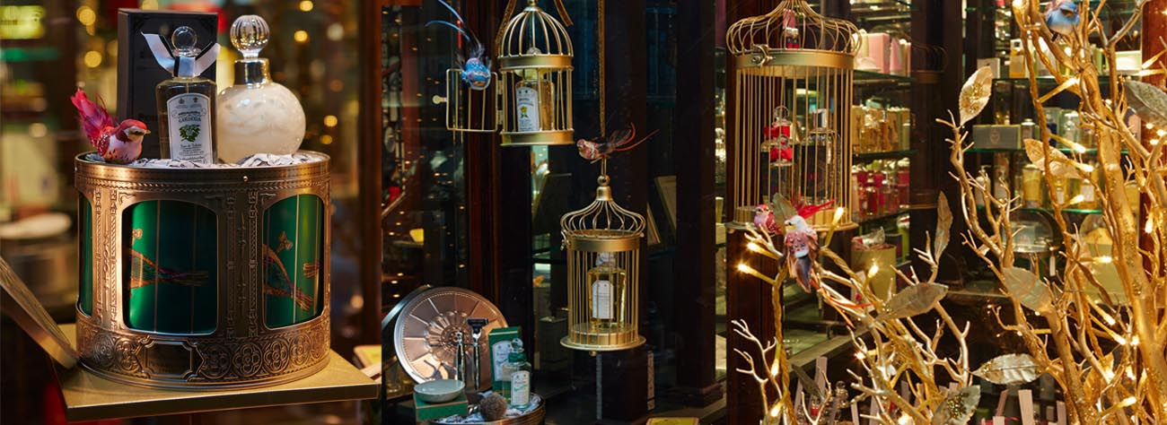 Images from the Christmas Penhaligon's window display, showing the company's perfume bottles and Prop Studios' bespoke bird cages