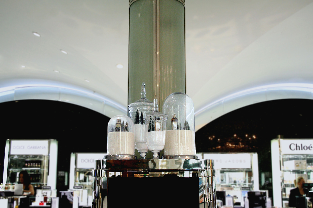 Prop Studios' bespoke snow globes were designed and installed within Harrods' Black Hall Perfumery