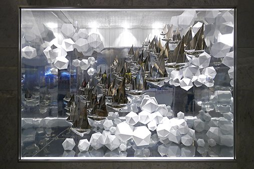 As part of the visual merchandising display, Prop Studios designed two window schemes featuring an abundance of silver miniature ships in a sea of waves