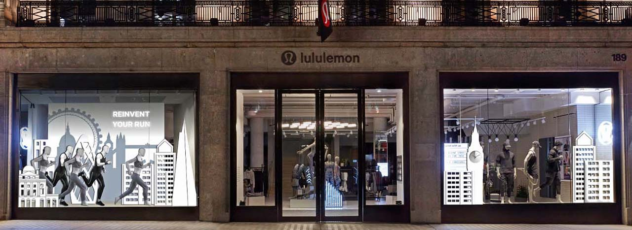 Exterior view of the Lululemon flagship store with London marathon-themed window scheme designed by Prop Studios