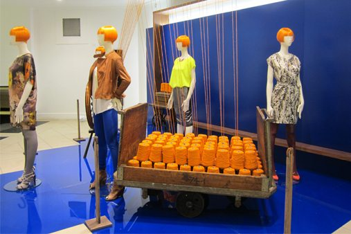 The orange wool used in the design originated from a series of spools showcased at the focus point of Prop Studios' visual merchandising scheme