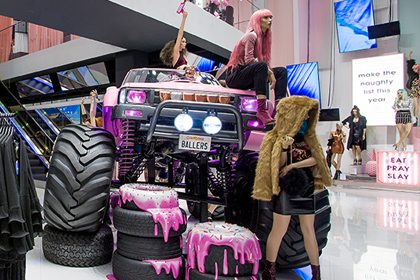 The monster truck is the focal point of Missguided's entrance, and is surrounded by oversized donut tyres, dripping with icing and sprinkles