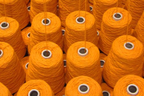 Prop Studios sourced the spools of bright orange wool from British wool millenaries