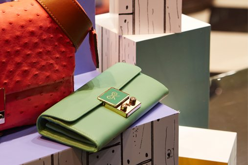 Close-up shot of an Anya Hindmarch purse on top of one of Prop Studios' hand-painted plinths for the colour block window scheme