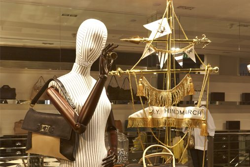 Close-up of a mannequin and boat, designed as part of Prop Studios' nautical themed Anya Hindmarch window display