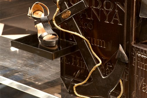 Close-up of a shoe alongside an anchor, designed by Prop Studios as part of the nautical themed window display for Anya Hindmarch