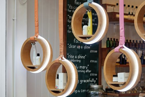 LED light rings displaying products in the window display of Facegym's flagship store
