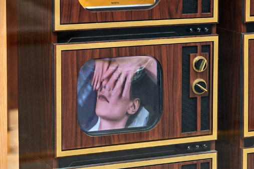 Close-up of TV screens within the Facegym window display