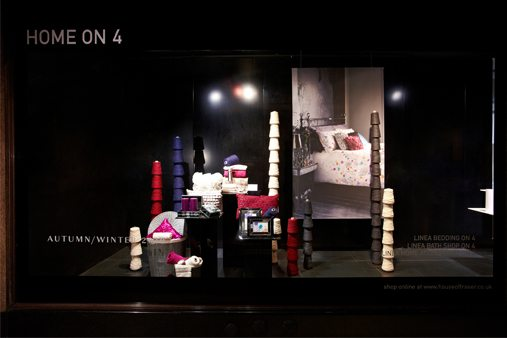 Part of our House Of Fraser window schemes, containing spools of cotton and fabric samples