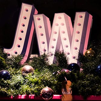Close-up image of bespoke lit lettering, designed exclusively for Jack Wills by Prop Studios