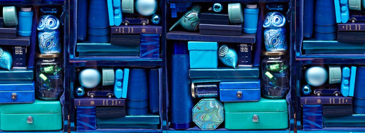 Full view of the Anya Hindmarch window scheme, containing blue acrylic crates designed by Prop Studios