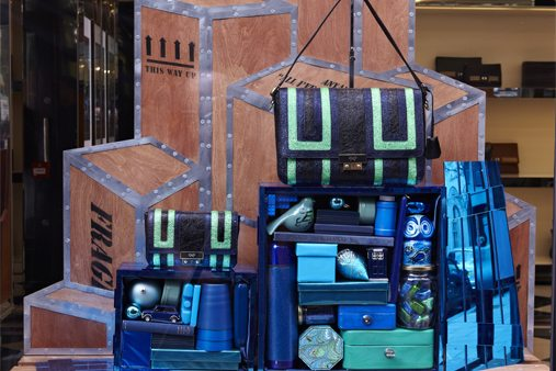 Prop Studios created bespoke crates clad with blue mirror acrylic, filled with items to reflect the Ebenezer bag campaign