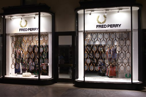 Exterior shot of the Fred Perry store, with Prop Studios' hand-crafted racquets suspended in the window