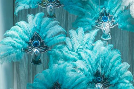 Close-up shot of head dresses and fans, designed to create a Rio Carnival theme for Al Rubaiyat's windows
