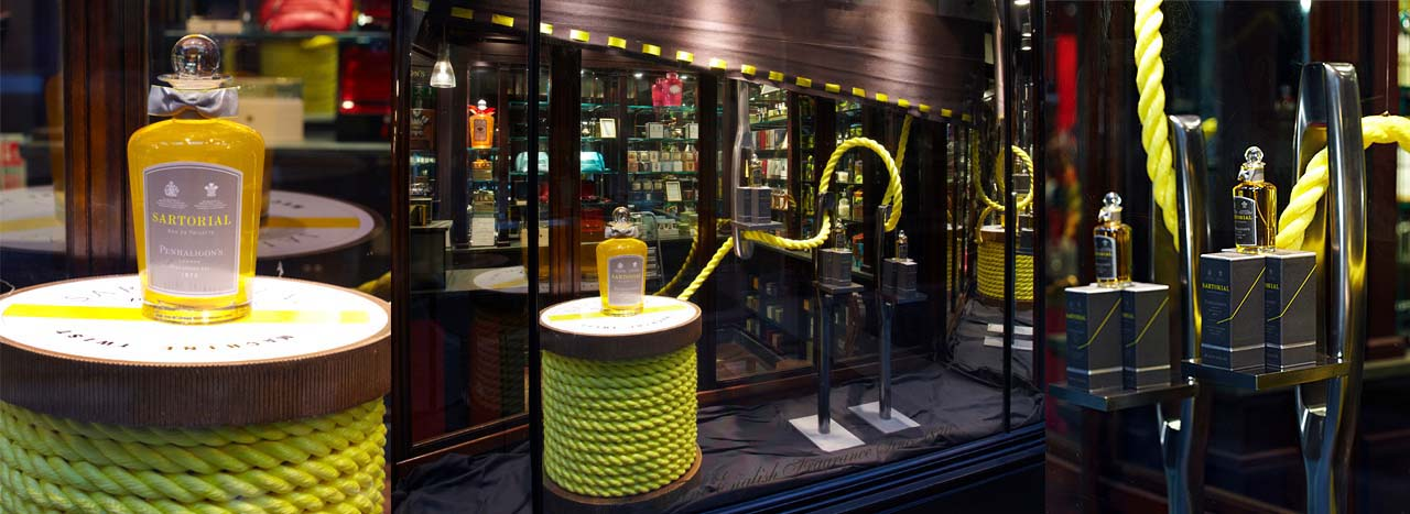 Prop Studios wrapped the reels with neon yellow rope and used lengths of grey suit fabric and threaded yellow silk ribbon along the edges