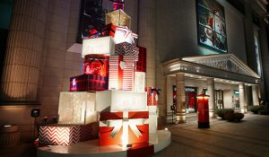 Outside the department store, Prop Studios created and installed a giant stack of oversized presents