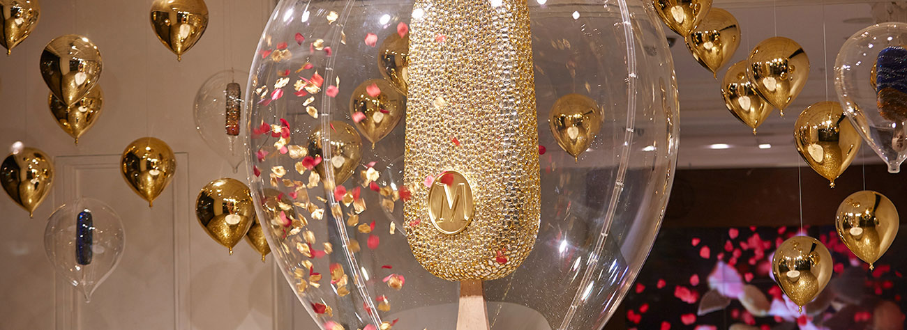 Close-up shot of the Prop Studios-designed glittering Magnum within a clear balloon