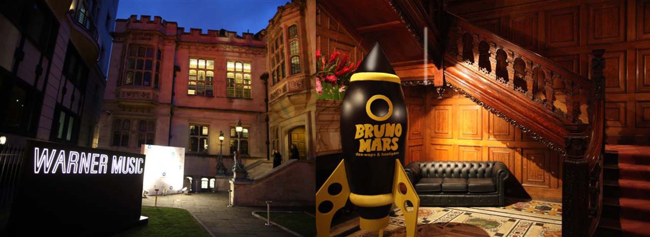 Image showing exterior of after party with Warner Music sign created by Prop Studios, and matt black rocket sculpture promoting singer Bruno Mars
