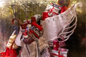 Close-up shot of the vintage sleigh, upholstered and designed by Prop Studios for Liberty's Christmas window display