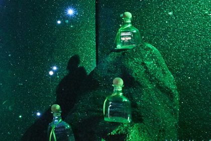 Image of three Patron bottles on display in the Selfridges window