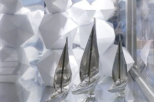 Close-up image of three miniature ships, designed and installed by Prop Studios in the windows of the Hyundai department store
