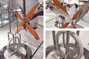 Bespoke unicycle sculpture with rose gold propeller, designed and installed by Prop Studios
