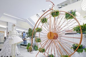 Prop Studios created a Ferris wheel equipped with plants and a leather seat as part of the bespoke visual merchandising scheme