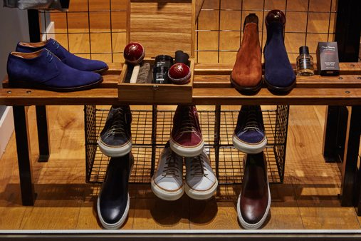 Close-up of shoes on display within the Oliver Sweeney window scheme