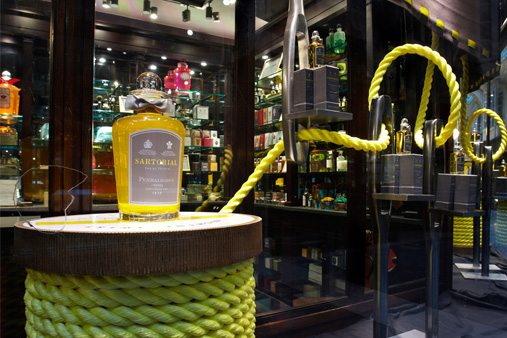 The Penhaligon's window scheme was based on Savile Row tailor Norton & Son, using oversized needles, threading and fabrics alongside giant cotton reels