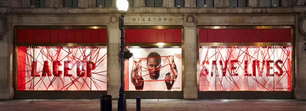 Full image of the Niketown windows, designed by Prop Studios for the Red charity campaign